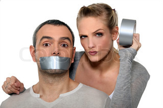 Woman taping-up boyfriend's mouth