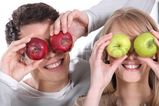 Covering her eyes with apples