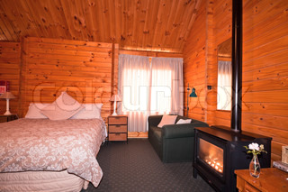 Lodge bedroom interior with fireplace