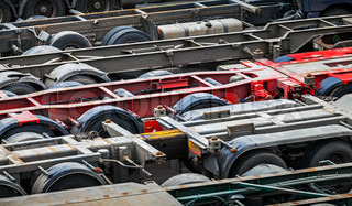 Automotive transportation abstract background with empty trucks cargo trailers