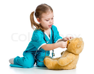 doctor girl playing and curing toy isolated on white background