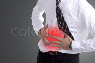businessman holding stomach for show his stomachache