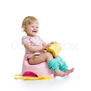 smiling baby sitting on chamber pot with toilet paper roll