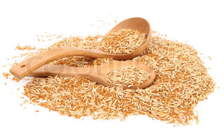 Two wooden spoons and pet food for birds. Seed mixture background.