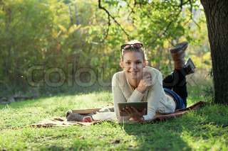 Smiling woman using computer outdoors