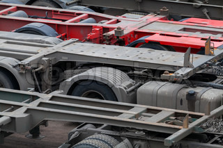 Industrial automotive transportation photo background with empty trucks cargo trailers