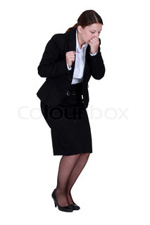 Businesswoman sneezing