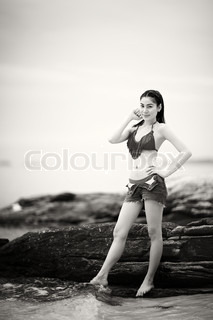monotone shot of beautiful woman in bikini on the beach with shallow depth of field and vignette, focus on eye