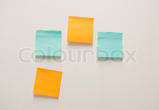 Blank paper on wall background