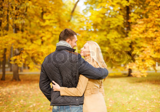 romantic couple kissing in the autumn park