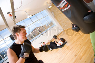 A man doing boxing training in a fitness center