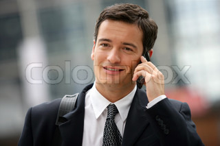 Busy businessman making call in between appointments