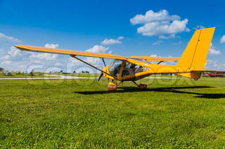 Yellow two-seater mini plane