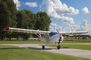 White two-seater mini plane