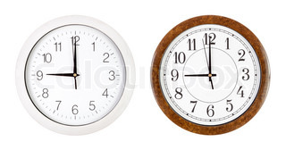 Two clock faces showing nine o'clock