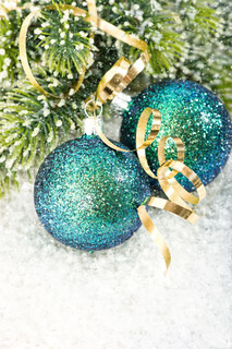 Blue Christmas Baubles With Christmas Tree Branch In Snow