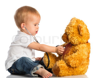 baby plays in doctor toy bear and stethoscope