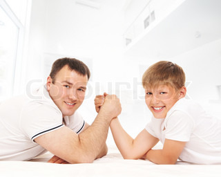 Father and son in arm-wrestling competition