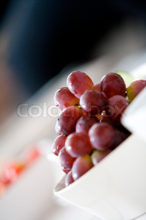 Fresh red grapes on a bowl