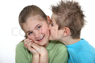 Boy kissing a girl on the cheek