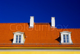 Orange roof against blue sky