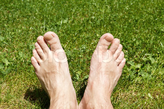 male legs on green grass