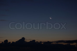 Night landscape with crescent in the dark blue sky