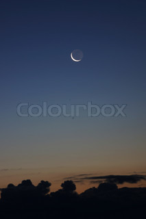 Night landscape with crescent in the sky