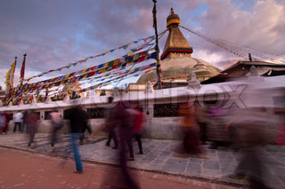 Kora People walking around Buddhist shrine Boudhanath Stupa at sunset Nepal, Kathmandu