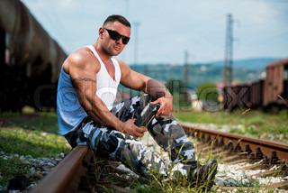 Billede af 'bodybuilder, flasker, én person'