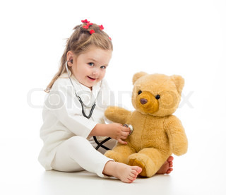 kid girl with clothes of doctor playing with toy