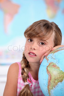 A little girl learning geography