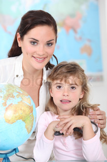 little girl and her teacher posing together