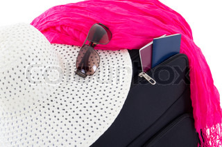 black suitcase with hat, sunglasses and passports