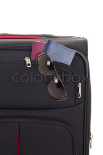 black suitcase with sunglasses and passports