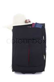 black suitcase with hat, sunglasses and passports isolated on white background