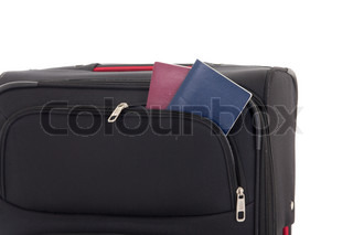 travel suitcase and passports isolated on white background