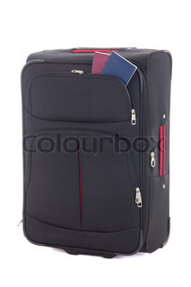 black travel suitcase and two passports isolated on white