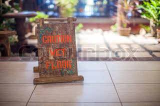 Sign at the small hotel-wet floor caution