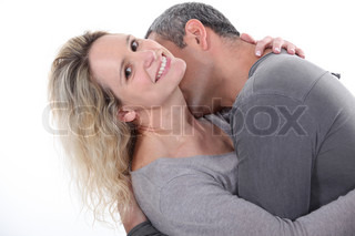 Man kissing wife's neck