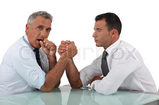 Businessmen doing arm wrestling