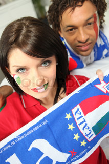 mixed race couple of italian soccer supporters