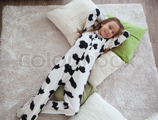 Child in cow print pajamas