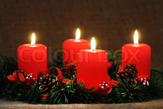 Four lit candles on Advent