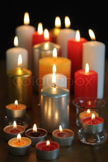 Beautiful lighted candles in different colors
