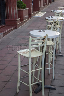 chairs and tables outside the cafe in the morning
