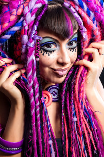 Portrait of a woman with multicolored dreadlocks and stylish make-up