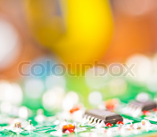 Detail of an electronic printed circuit board with many electrical components