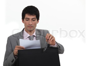 Businessman reading his notes