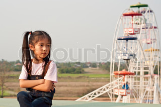 Little Asian girl in amusement park.